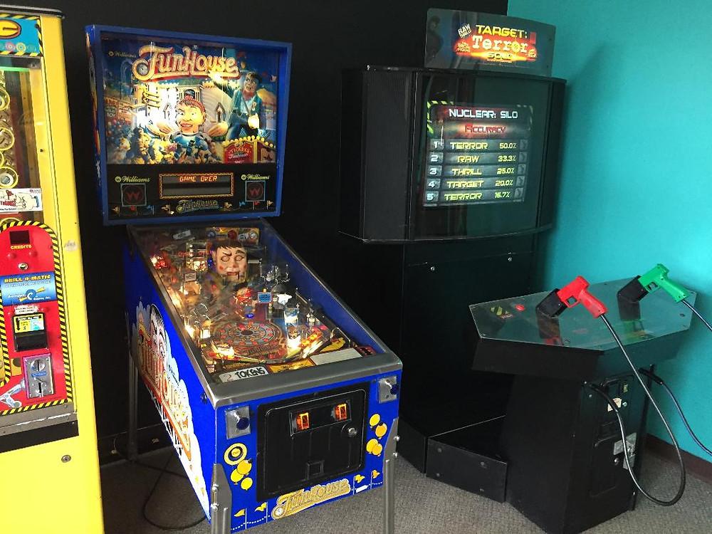 Williams Fun House pinball and Raw Thrills Target Terror in a Dynamo Showcase cabinet.