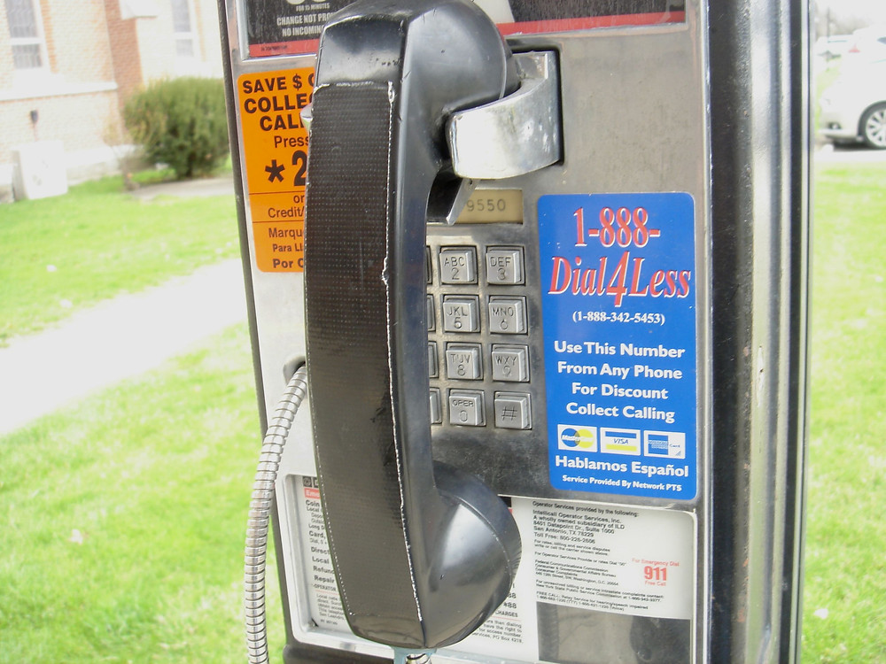 Working payphone receiver with tape on it.