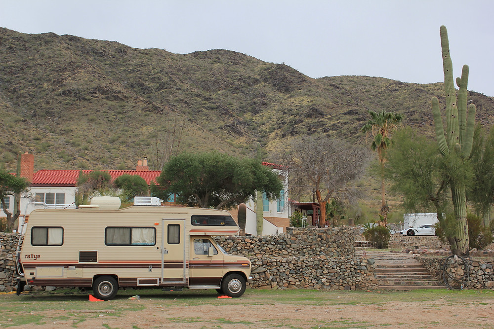 Vintage RV in front of Arizona mountains
