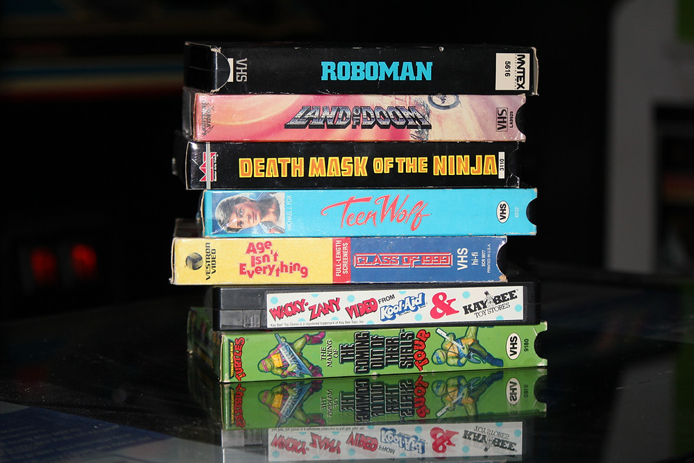 VHS tapes: Teen Wolf, Roboman, Land of Doom, Class of 1999, Kool-Aid and Kay-Bee Wacky Zany Video, Teenage Mutant Ninja Turtles TMNT Coming Out of their Shells tour.