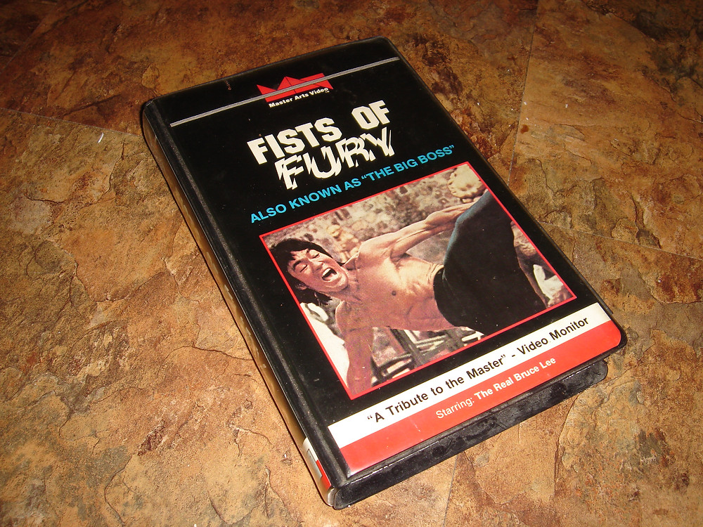 Bruce Lee Fists of Fury The Big Boss VHS rental tape with oversized clamshell case.