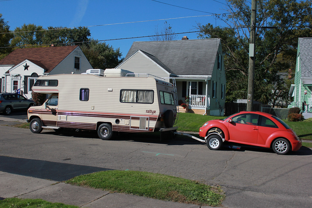 RV towing a Volkswagen Beetle