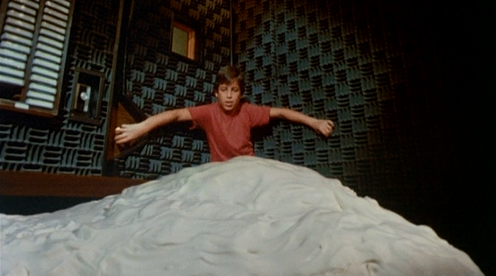 A pile of The Stuff tries to kill a boy in Larry Cohen's horror movie.