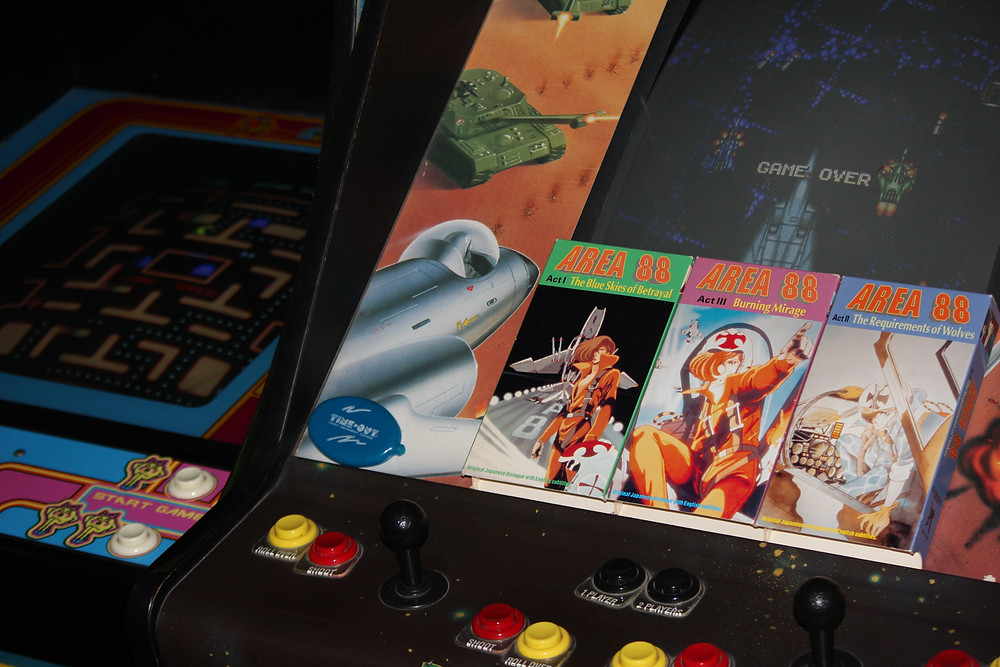 Area 88 VHS tapes on a Data East Vapor Trail arcade cabinet.
