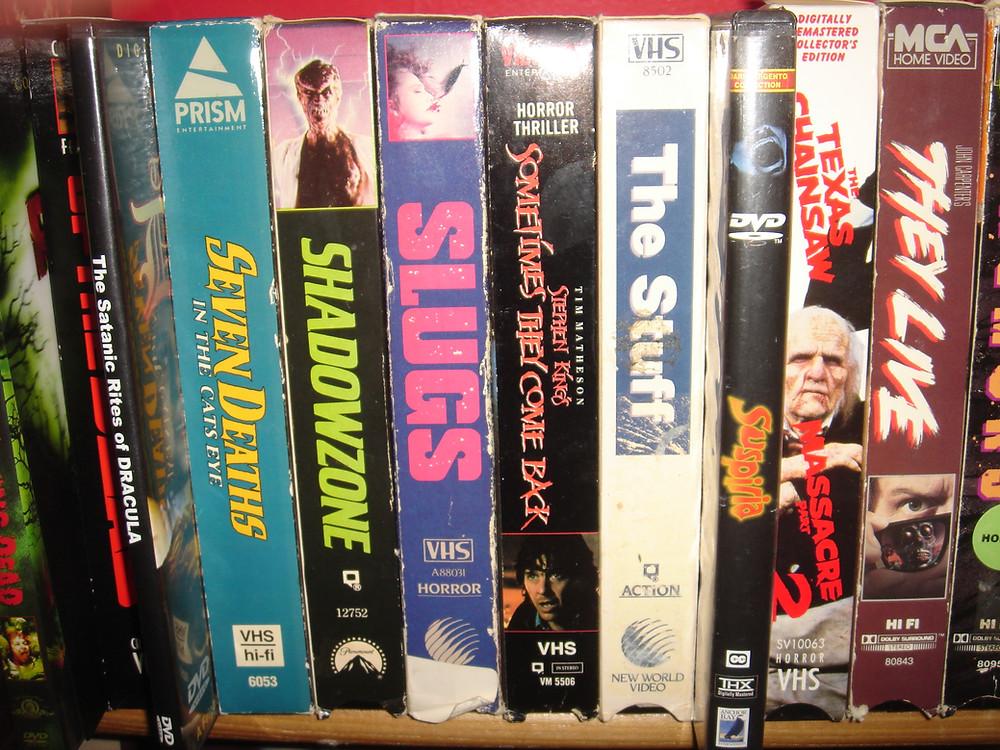 VHS horror films: They Live, Slugs, Texas Chainsaw Massacre, Tremors.
