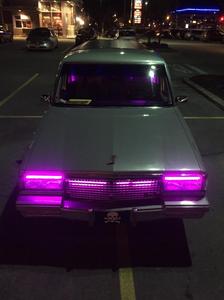 1987 Cadillac Fleetwood hearse with custom lighting.