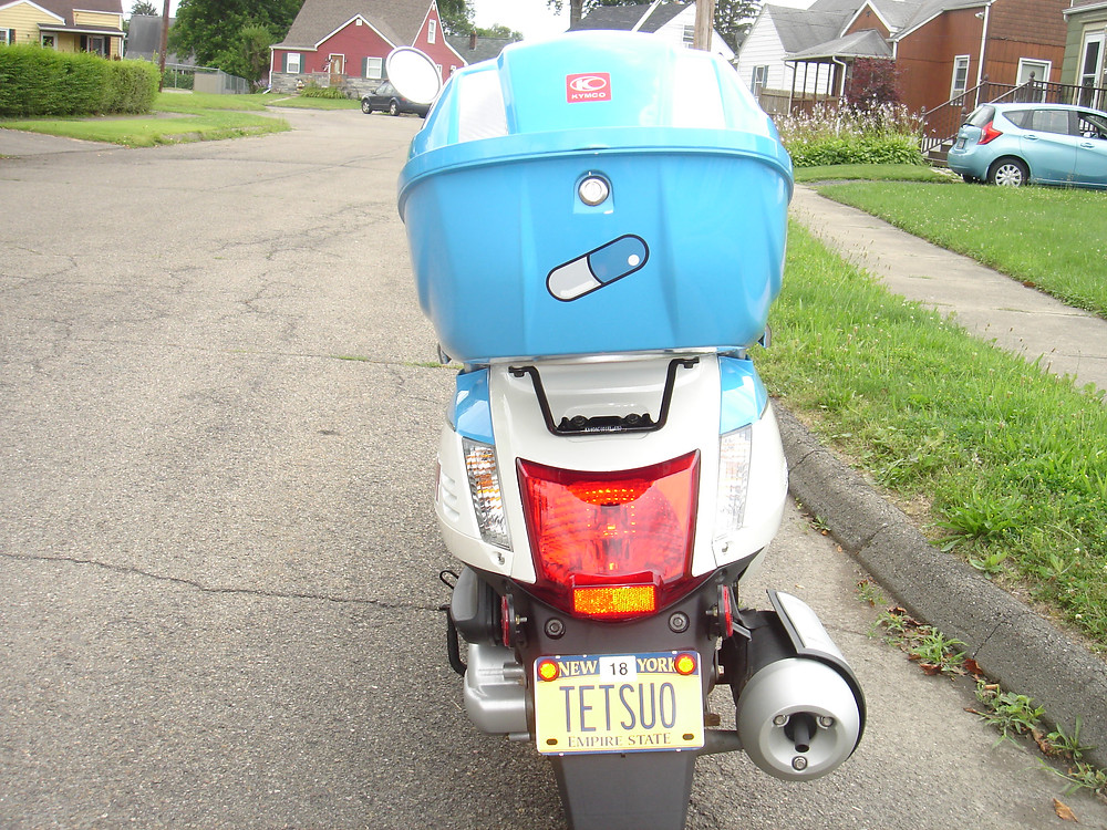 Scooter with Tetsuo Akira anime custom license plate.
