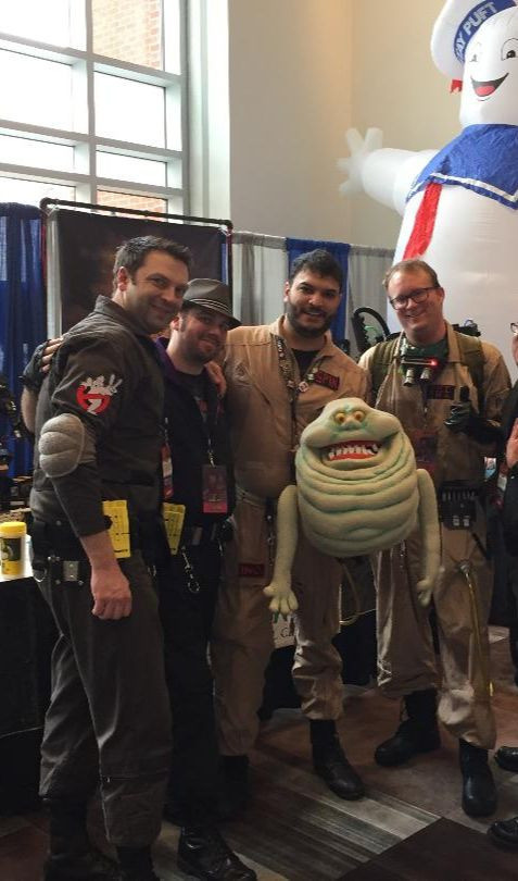 A group of Ghostbusters and the Stay-Puft Marshmallow Man.