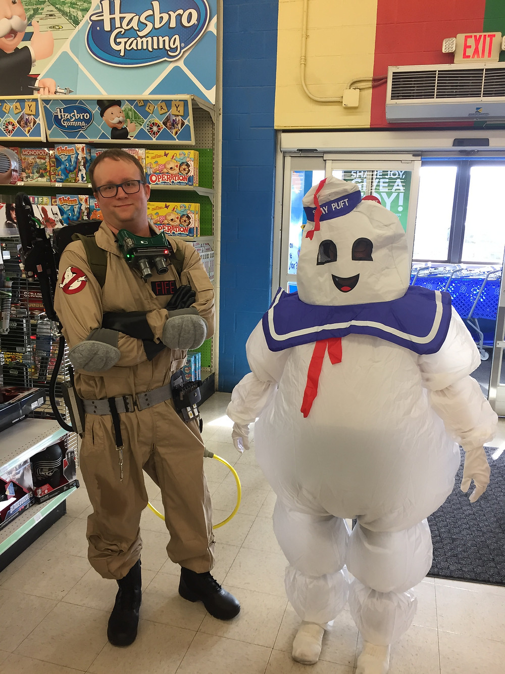 A Ghostbuster and the Stay-Puft Marshmallow Man.