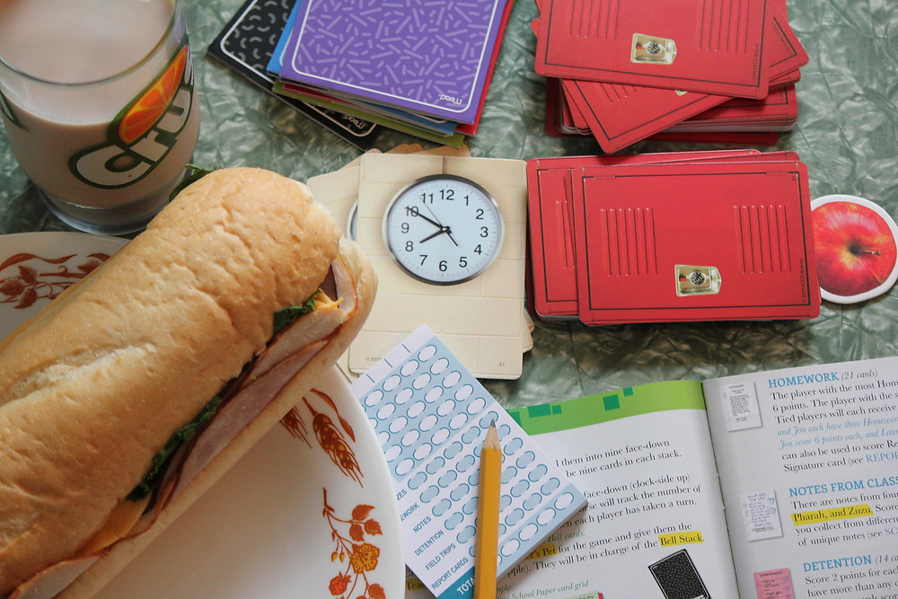 The Trapper Keeper Game from Big G Creative with a school lunch.