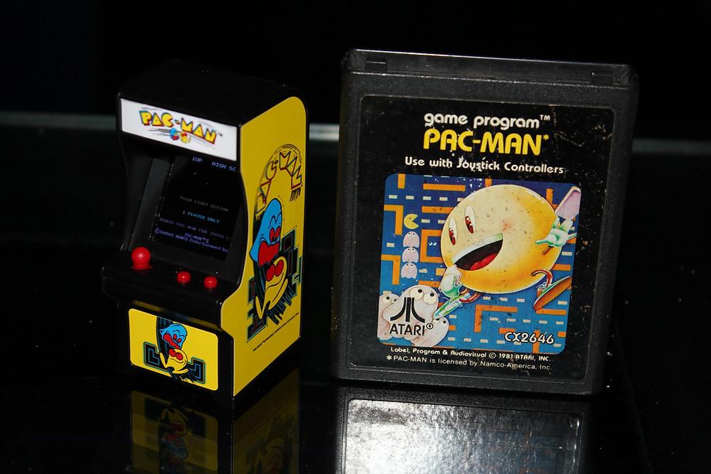 Super Impulse Tiny Arcade PAC-MAN key chain with Atari 2600 PAC-MAN cartridge.