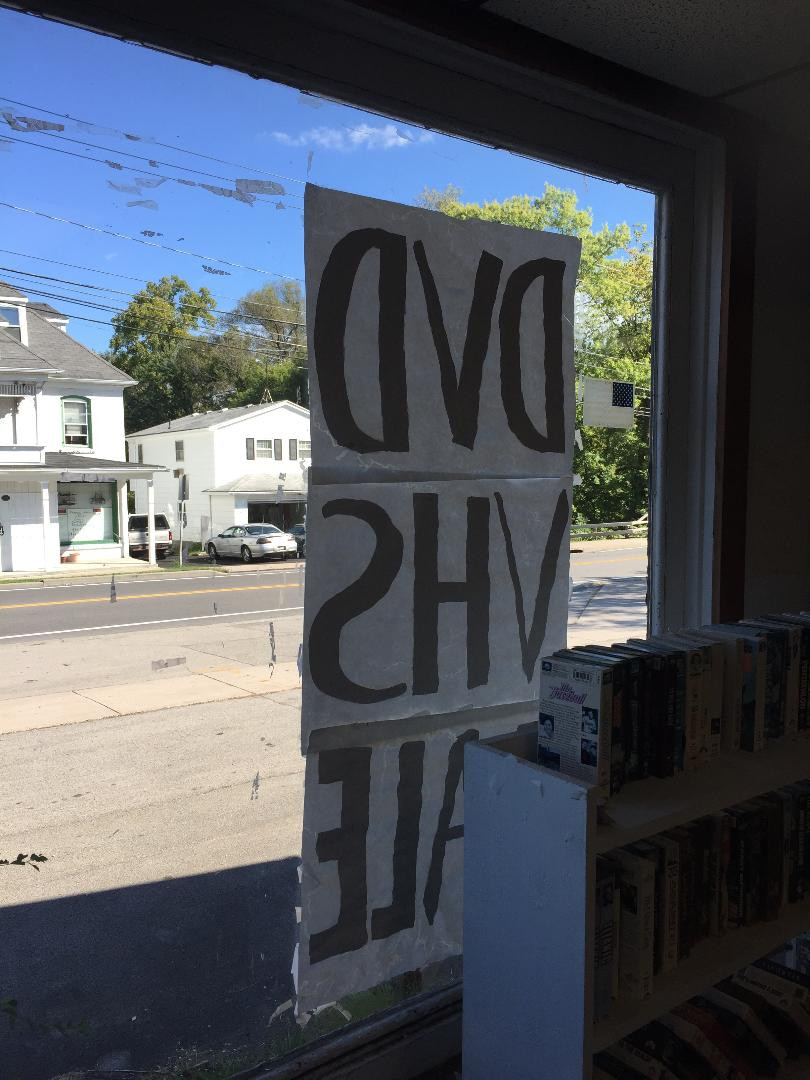 Looking out the window at a video store.