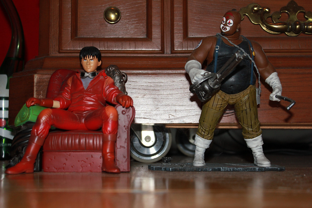 Figures of Kaneda and Joker from the anime Akira.