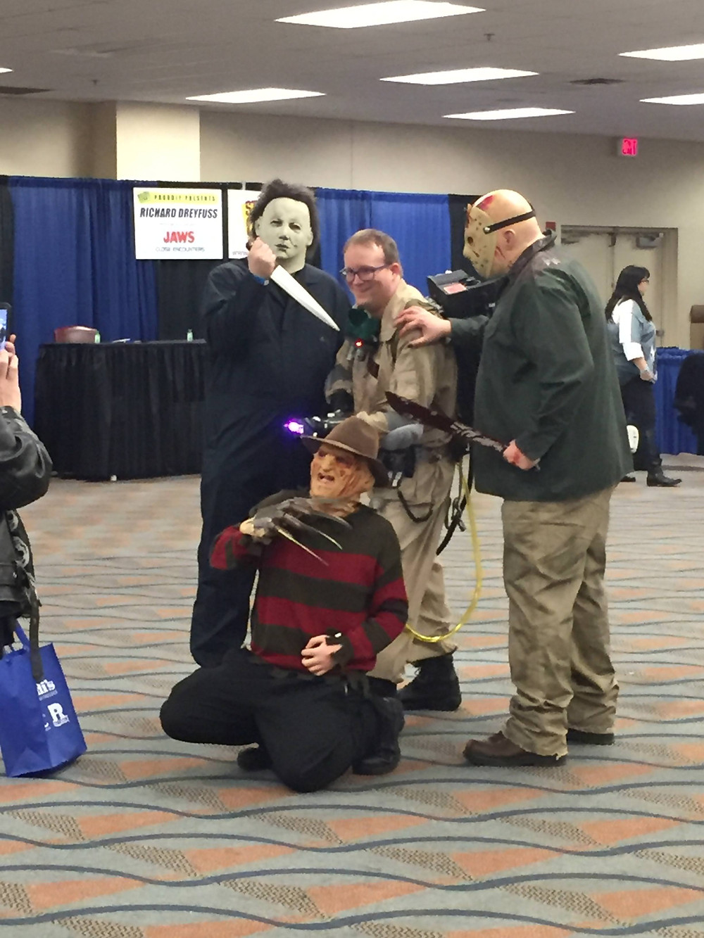Ghostbuster cosplay with Halloween Michael Myers, Friday the 13th Jason Vorhees and A Nightmare on Elm St. Freddy Kreuger.