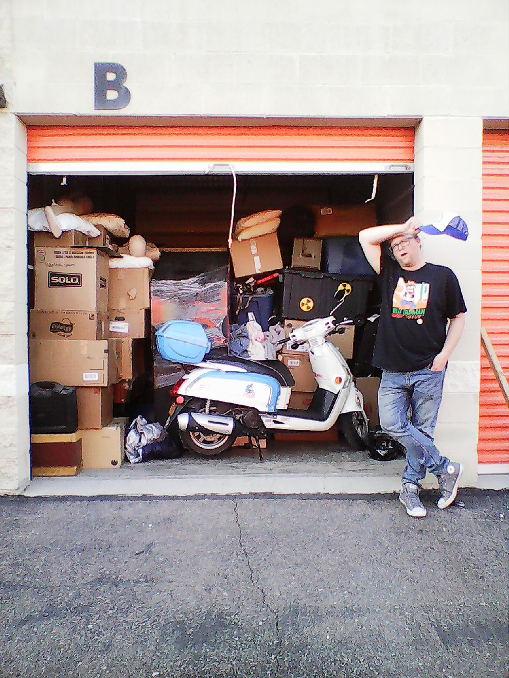 Full Public Storage unit with Kymco Like 200i LX scooter