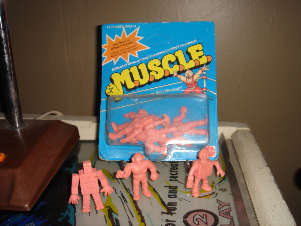 Unopened pack of M.U.S.C.L.E. figures.