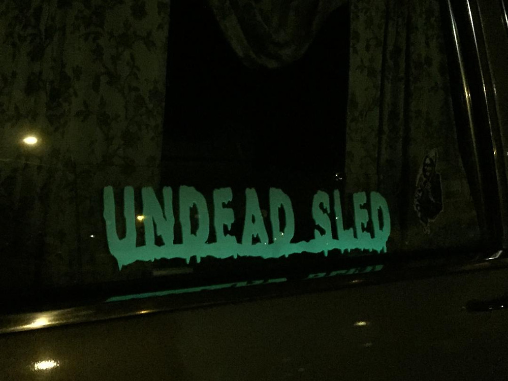Undead Sled glow in the dark 1987 Cadillac hearse window sign.