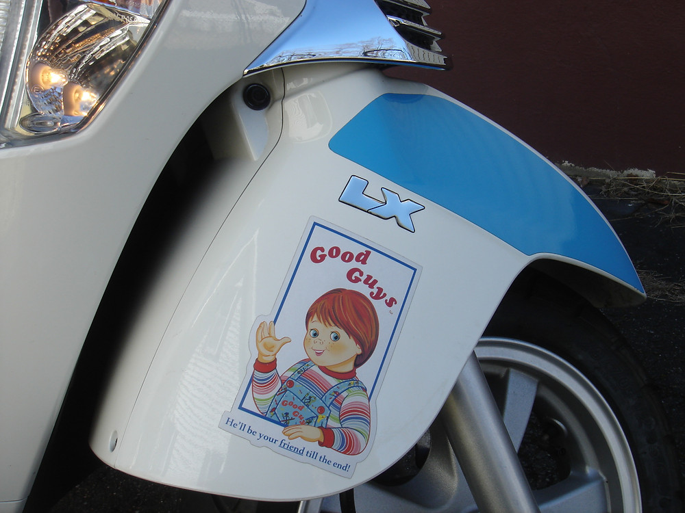 Child's Play Chucky decal sticker on Kymco scooter.