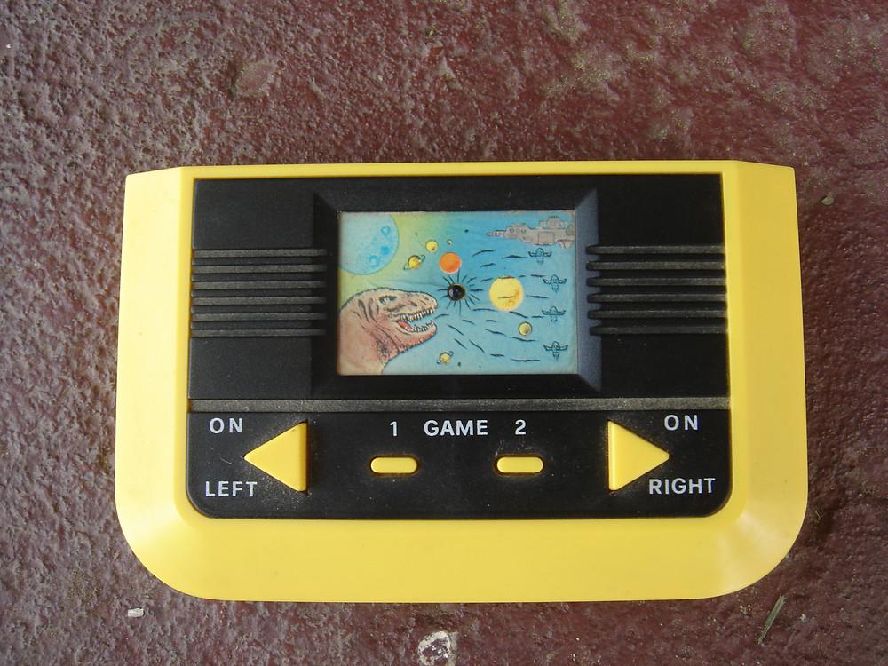 LCD handheld video game water-squirting practical joke.