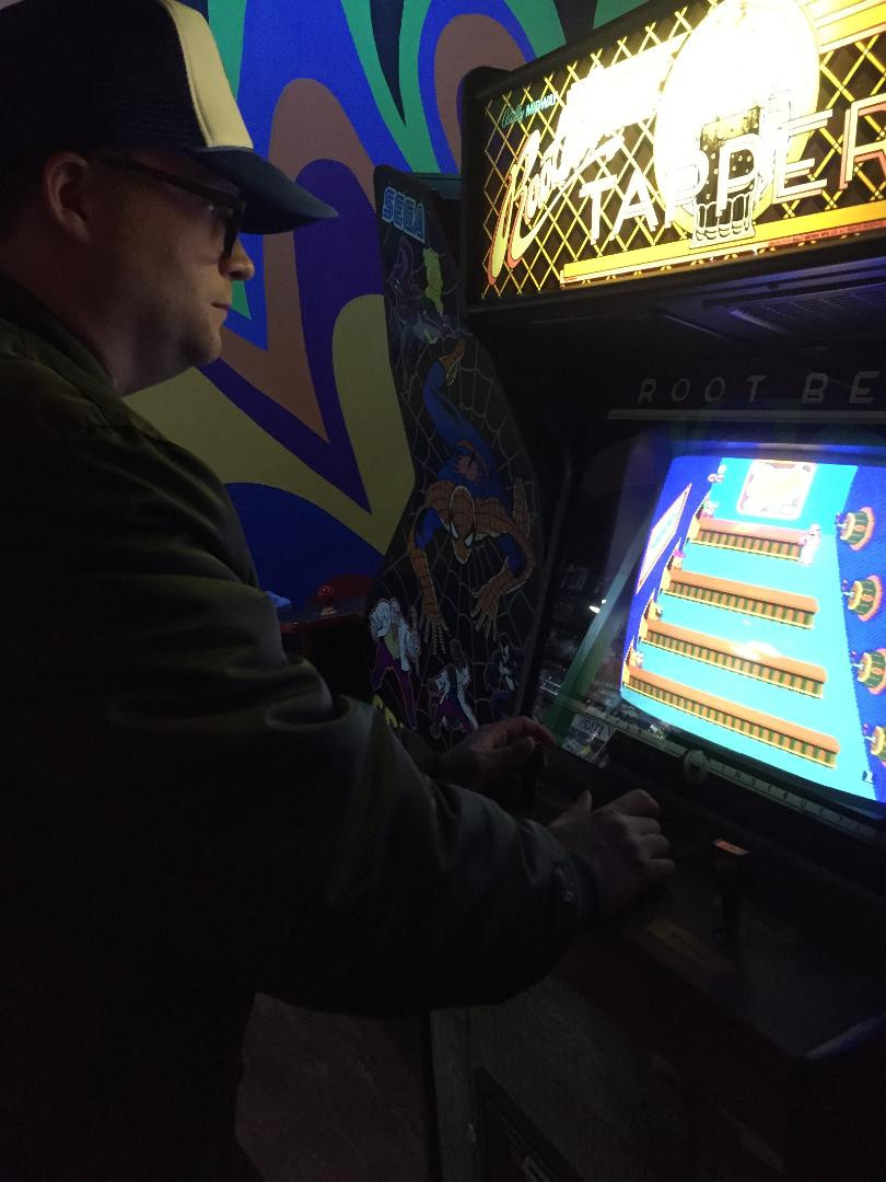 Man playing Root Beer Tapper at Robot City Games, Binghamton, NY