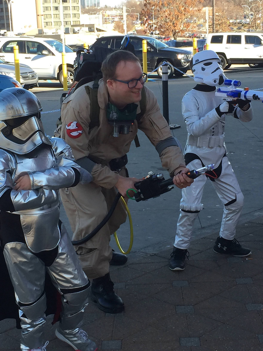 Ghostbuster cosplay with Star Wars stormtroopers at Steel City Comic Con.