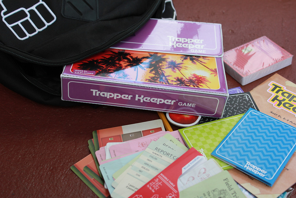 The Trapper Keeper Game from Big G Creative spilling out of a backpack.