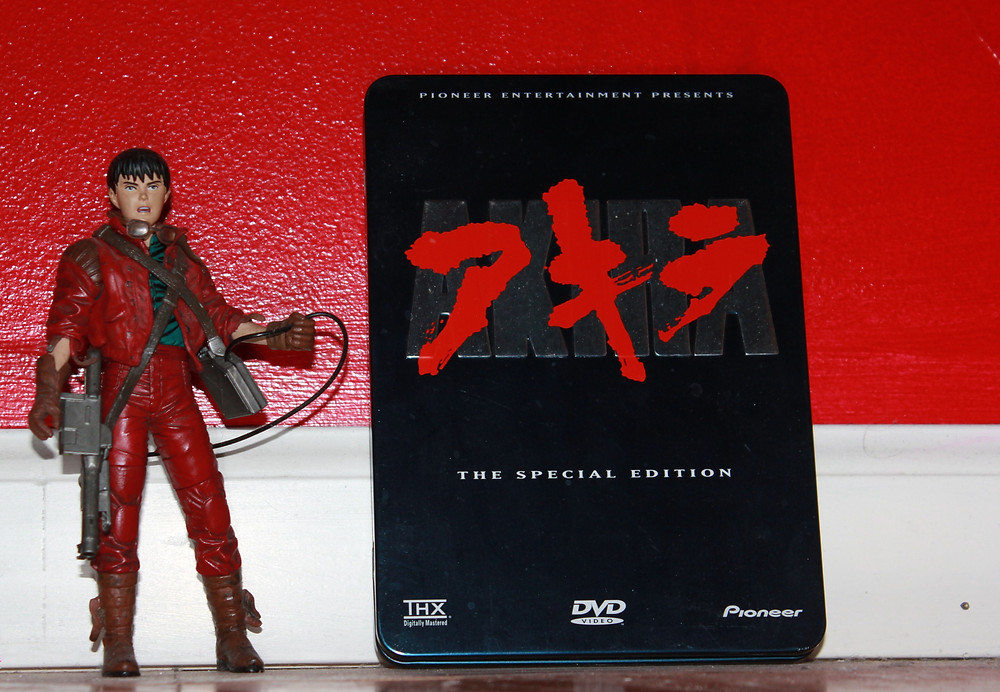 Akira Pioneer Special Edition tin with Todd McFarlane Kaneda action figure.