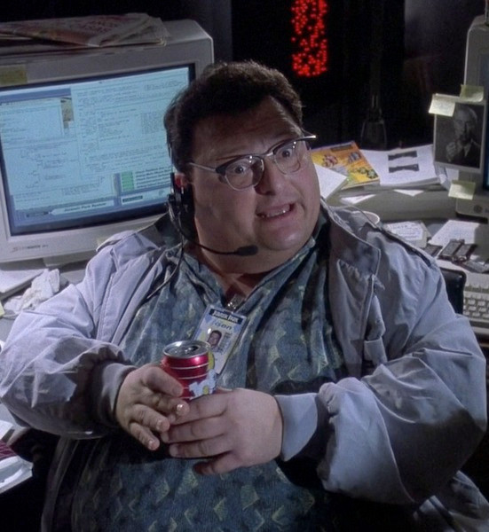 Wayne Night as Dennis Nedry drinking a  Jolt Cola in Jurassic Park.