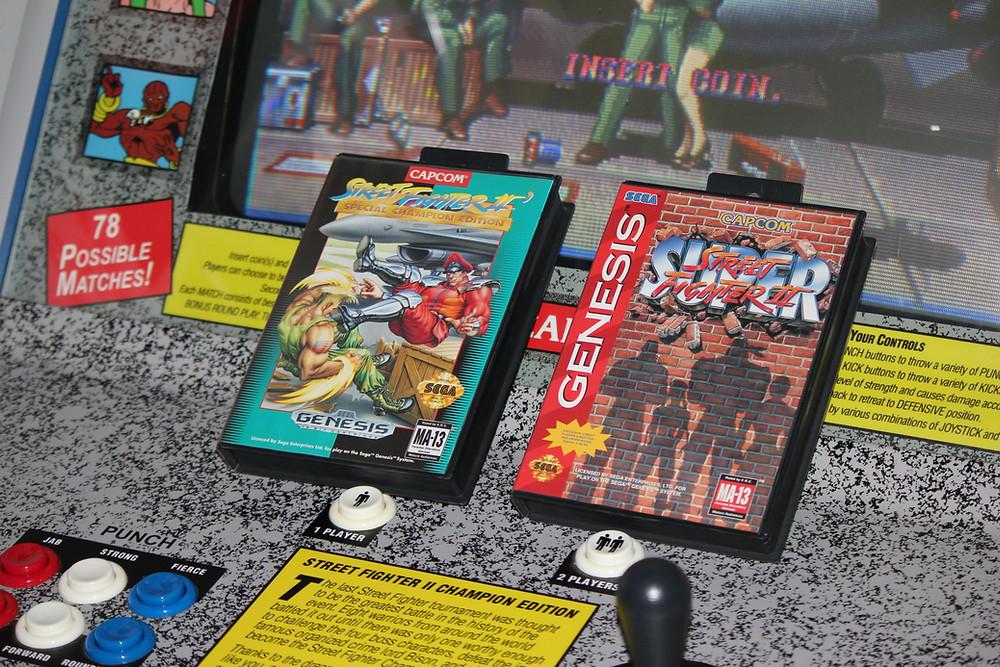 Street Fighter Sega Genesis cartridges on a Street Fighter II: Champion Edition arcade machine.
