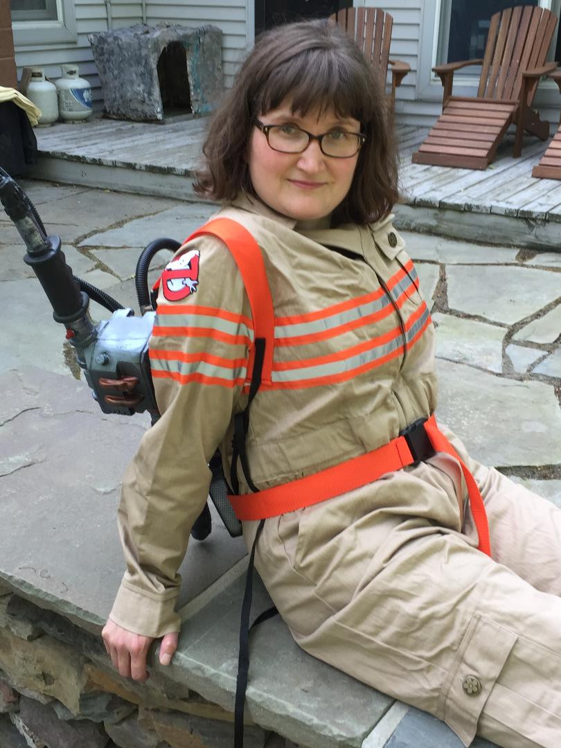 Adrienne Fife poses in a reboot Ruby's Grand Heritage Ghostbusters uniform with proton pack.