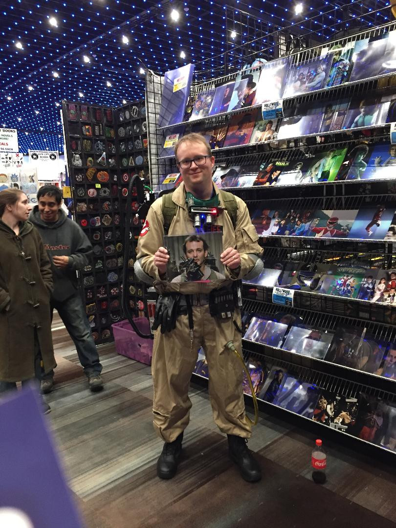 Ghostbuster holds autographed photo of Bill Murray as Peter Venkman.