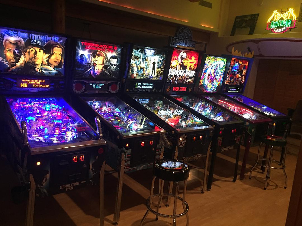 Pinball machines in home arcade: Demolition Man, Terminator 2, The Twilight Zone, Jurassic Park, Cirqus Voltaire, Rocky and Bullwinkle