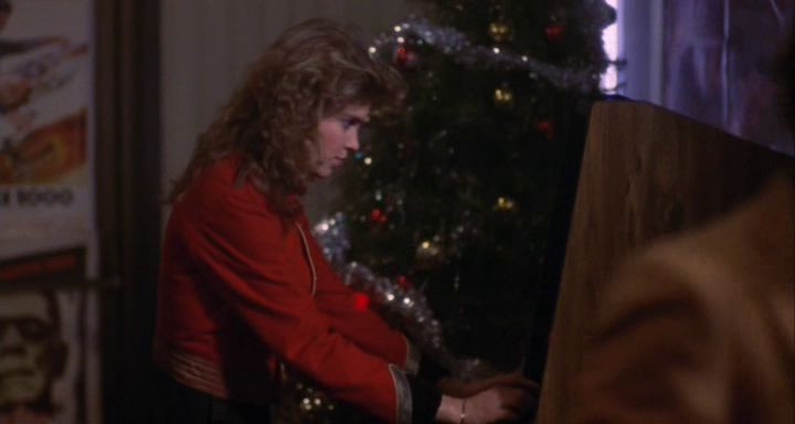 Catherine Mary Stewart as Regina Belmont plays Atari Tempest arcade game in Night of the Comet.