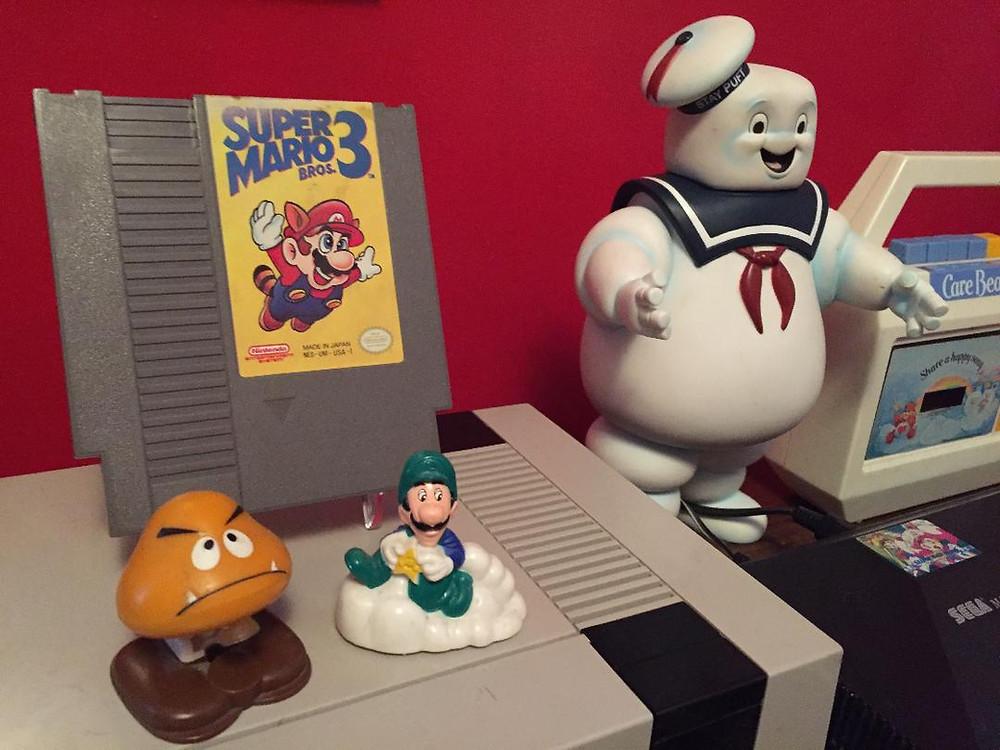 Super Mario Bros. 3 cartridge with Nintendo and Mario Bros. McDonald's Happy Meal toys.