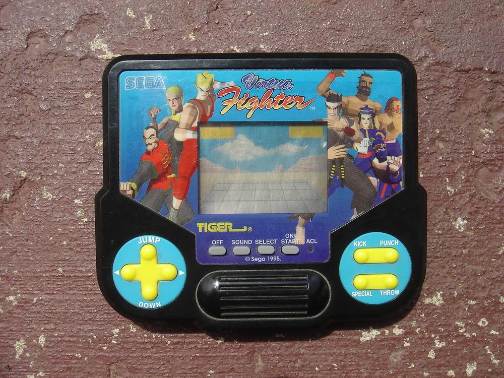 Tiger Sega Virtua Fighter handheld LCD videogame.