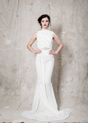 Designer: Covet Collection  Description: Ivory Guipere Lace gown with embellished belt detail and train.  Sizes Available: 6-16  Purchase Price: Upon consultation  Rental Price: Not Available