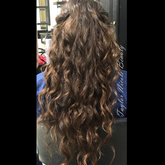 Long brunette sprial curls