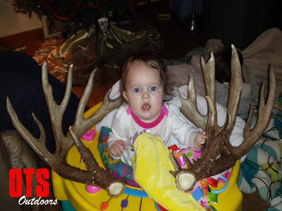 Baby with Kreidermacher sheds MN Record Buck Over the Shoulder.png