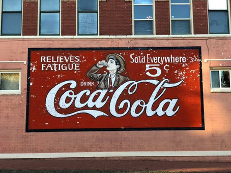 A self-guided walking tour of Guthrie hand-painted signs, murals, and ghost signs