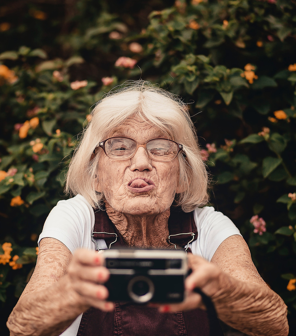 old woman taking a selfie
