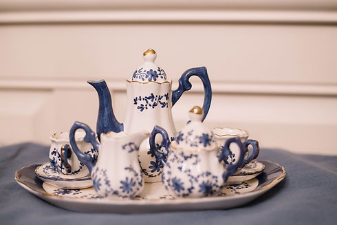 A tiny blue and white floral tea set