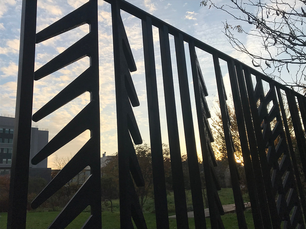 A photo of a gate at the Weeksville Heritage Center in Brooklyn, NY.