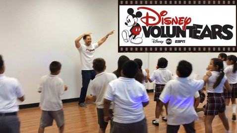 """I was given the opportunity by Disney VoluntEARS to help teach over 200 children at a volunteer organization that assists some of the neediest residents of the San Fernando Valley – poor children and their struggling families.  This was a humbling experience that reminded me to appreciate EVERYTHING in life, no matter how little or big.  Getting to work with the kids was such a joyful time.  I mean how could it not?  I taught them the """"Funky Cowboy""""."""