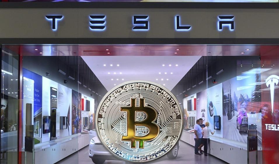 Entrada de Tienda de Tesla Motors con la criptomoneda de bitcoin.
