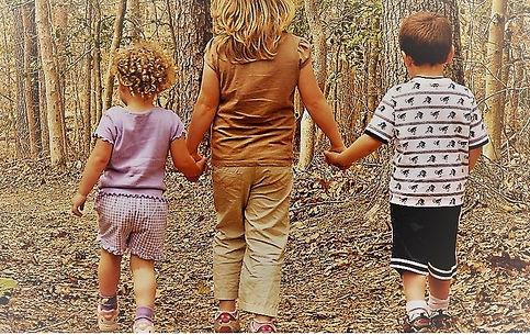 kids walking in forest.JPG