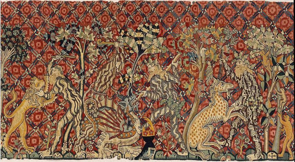 Wartburg tapestry close up of wild men wrestling animals