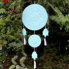 blue buddha mobile in tree.jpeg