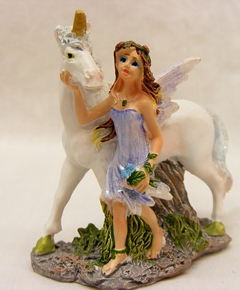 Unicorn with fairy in a blue dress