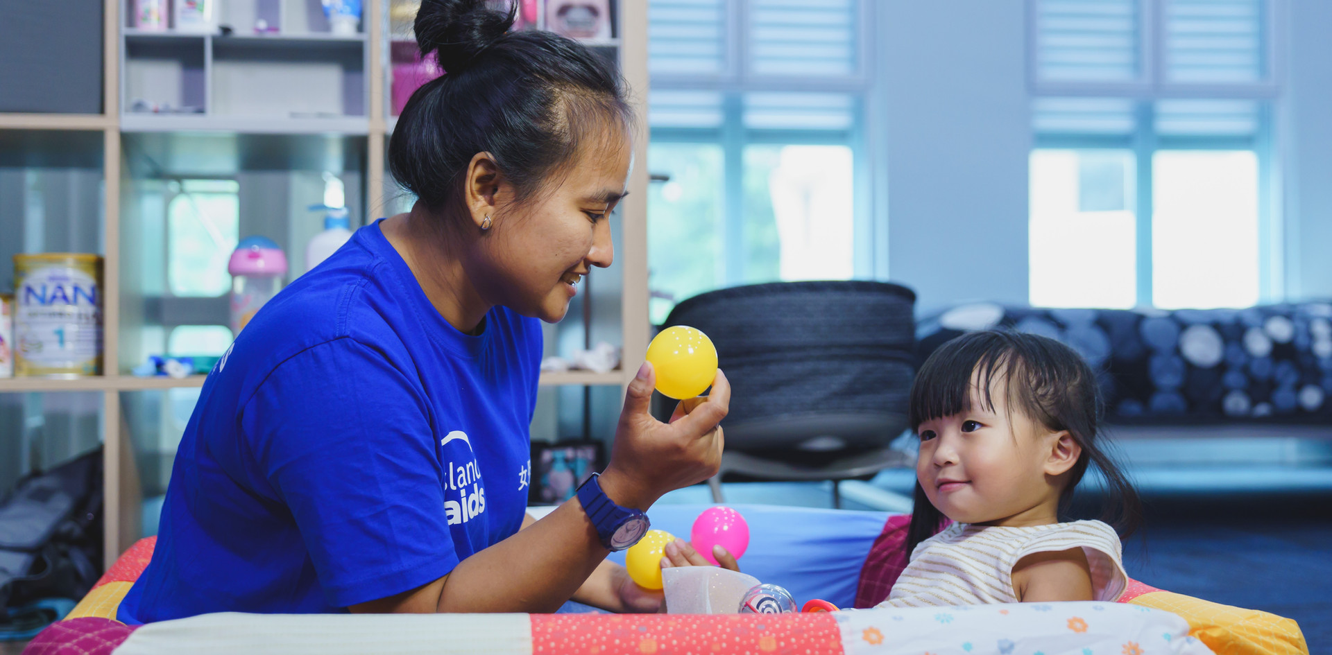 Maid caring for a child in Singapore