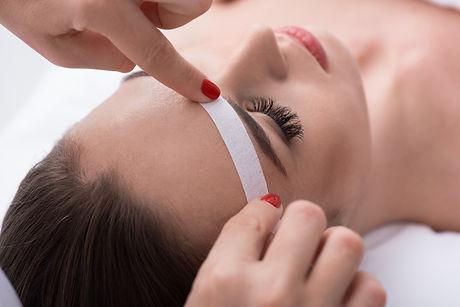 Canva - Cosmetician undergoing waxing pr